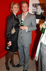 MISS MICKEY SUMNER daughter of singer Sting and MR BEN TOWILL at a private view of an exhibition of photographs by the late Robert Mapplethorpe curated by artist David Hockney at the Alison Jacques Gallery, 4 Clifford Street, London W1 on 13th January 2005.<br /><br />NON EXCLUSIVE - WORLD RIGHTS