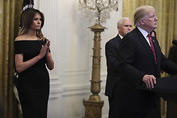 President Donald Trump accompanied by first Lady Melania Trump and Vice President Mike Pence, second right, speaks during a Hanukkah reception in the East Room of the White House on December 6, 2018 in Washington, DC. Behind Trump, Vice President Mike Pence. (Photo by Oliver Contreras/SIPA USA)