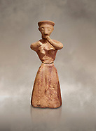 Minoan clay female figurine in the attitude of worship, Chamezi 1900-1700 BC; Heraklion Archaeological  Museum. .<br /> <br /> If you prefer to buy from our ALAMY PHOTO LIBRARY  Collection visit : https://www.alamy.com/portfolio/paul-williams-funkystock/minoan-art-artefacts.html . Type -   Heraklion   - into the LOWER SEARCH WITHIN GALLERY box. Refine search by adding background colour, place, museum etc<br /> <br /> Visit our MINOAN ART PHOTO COLLECTIONS for more photos to download  as wall art prints https://funkystock.photoshelter.com/gallery-collection/Ancient-Minoans-Art-Artefacts-Antiquities-Historic-Places-Pictures-Images-of/C0000ricT2SU_M9w