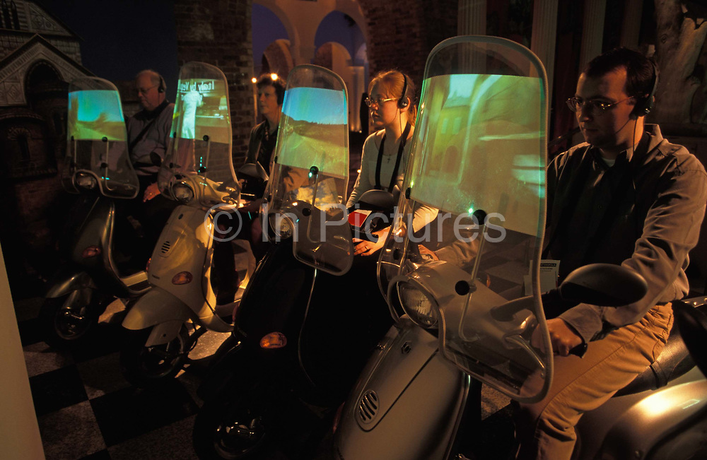 Visitors experience an interactive travel exhibit in The Millennium Dome later to become the 02 Arena weeks after the Millennium, on 14th January 2000, in London, England.