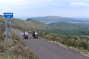 4-5-2017: Husband and wife, Mark and Pauline Lucas from Cahersiveen, County Kerry pictured at Bray Head on Valentia Island along the Wild Atlantic Way and Skellig Ring in County Kerry on Thursday for the launch of Ireland BikeFest Killarney 2017. The three-day festival attracts motorcyclists in their tens of thousands from all over the world who will participate in a number of ride-outs on the Wild Atlantic Way as part of the festival programme. The fantastic scenery, touring routes, hospitality and free live entertainment make it one of the must attend and unique festivals of the year which takes place in Killarney this June Bank Holiday weekend.  <br /> Photo Don MacMonagle<br /> <br /> REPRO FREE PHOTO FROM IRELAND BIKEFEST<br /> Further info:: <br /> <br /> PRESS RELEASE: Get Your Motors Running for Ireland BikeFest <br /> June 2nd to 5th 2017<br /> We just can't wait to get on the road again for Ireland BikeFest 2017 which rumbles into Killarney across the June Bank Holiday weekend. Now in its eleventh year, Ireland BikeFest is an action-packed, three-day festival that attracts motorcyclists in their tens of thousands from all over the world to the Kingdom. The fantastic scenery, touring routes, hospitality and free entertainment make it one of the must attend festivals of the year.  <br /> <br /> Highlights for 2017 include daily ride outs along the Southwest section of the the Wild Atlantic Way - marshalled by Celtic Thunder Chapter Ireland and Gaelic Chapter Ireland, free Harley-Davidson® demo rides, Waterford and Dublin Harley-Davidson® Dealers, H.O.G.® Hospitality & Info, Jumpstart, Novelty Dog Show, the Custom Bike Show, Parade and lots of free live indoor and outdoor entertainment day and night. <br /> <br /> This year's line-up of entertainment is epic and with free entry to all Ireland BikeFest gigs there's simply no excuse not to go!  Three days, three stages and tons of free live music - there's the Outdoor Stage located at the heart of the Bike Vill