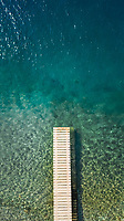 Aerial view of a pontoon in the mediterranean sea.