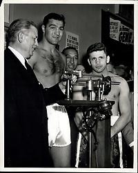 Sept. 1953 - Rocky Marciano vs Roland La Starza weigh in pre fight (Credit Image: © Keystone Pictures USA/ZUMAPRESS.com)