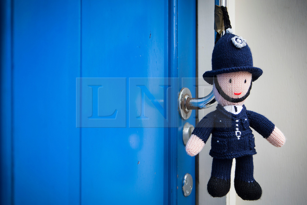 © Licensed to London News Pictures. 27/04/2016. Thirsk UK. Picture shows a knitted Police man on the local police station in Thirsk that has been Yarn Bombed. Under the cover of Darkness 300 Yarn bombing street artist's have covered the Town centre of Thirsk, the group has covered bollards, flower pots, the bus stop, tree's, benches, even the local police station. The knitted creations took over 750 balls of wool & have been placed along the route of the Tour De Yorkshire which will pass through the town during it's final stage from Middlesborough to Scarborough on Sunday.  Photo credit: Andrew McCaren/LNP