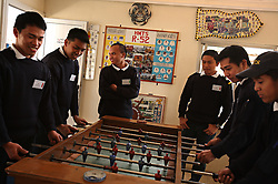 """Filipino seafarers play foosball in Limassol, Cyprus on Feb. 22, 2008. Filipino seafarers attend classes in Limassol because Cyprus is the crossroads of international ship management and  where all the agencies are recruiting and hiring the cheapest workers worldwide. Cyprus is also one of the """"Flag-of-Convenience"""" States like Panama and Liberia."""