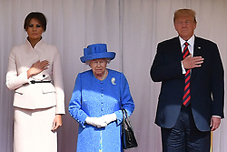 Queen Elizabeth II, US President Donald Trump and First Lady Melania Trump listen to the US national anthem during a ceremonial welcome at Windsor Castle, Windsor.