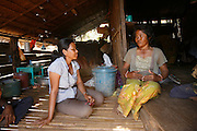 Koeun visiting one of her students, a Traditional Birth Attendant (TBA). Her name is Kachay from Mohaphal village in Preah Vihear..Touth Koeun, an ex-Khmer Rouge child soldier turned midwife and trainer, is on the frontline again, but this time campaigning on maternity issues, in Preah Vihear province, Cambodia. The country experiences an extraordinarily high incidence of infant and maternal mortality. The Preah Vihear province, in Cambodia's north, bordering on the Thai border, can be described as an outback rural area, villages often many hours away from a health centre or clinic, and sometimes near the frontline where soldiers and their families are living. Here, Touth Kouen, a locally much respected pioneer and experienced in maternity issues, trains indigenous women, known as 'Traditional Birth Attendants' (TBA's), correct procedures to assist midwives and nurses, to give direct support to mothers and their babies, during ante and post natal periods. Traditional bush medicine and spiritual practices by 'Kruu' bush doctors, involving the killing of endangered species, gathering herbs and plants, whose burnt remains are often ground up into unhealthy potions, and fed to mothers as miracle cures, and postpartum heating, can cause illness and death. The Kruu, and local people in general need to be re-educated, so as to create a healthy nurturing environment for mothers and their babies. Preah Vihear Province, Cambodia