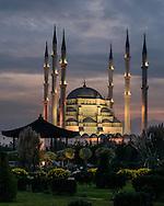 Sabanci Merkez Camii, Adana Mosque is illuminated by lights at sunset