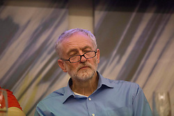 © Licensed to London News Pictures. 25/08/2015. Southampton, UK.  Jeremy Corbyn appears to nearly nod off at a Q & A at a rally held in the Hilton at the Ageas Bowl in Southampton after rumours for a Labour split.
