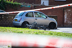 A Boris Bike lies on its side as a cordon remains in place around the scene of a knife fight that left four teenagers injured on the Elmington Estate, between Marvell House and Landor House. London, August 17 2018.