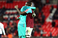 Adrian of West Ham United (L) celebrates with Cheikhou Kouyate of West Ham United (R) at the final whistle. EFL Carabao Cup, 4th round match, Tottenham Hotspur v West Ham United at Wembley Stadium in London on Wednesday 25th October 2017.<br /> pic by Steffan Bowen, Andrew Orchard sports photography.