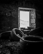 Abandoned tyres inside a derelict house near Fainmore in Scotland.