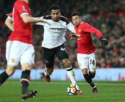 5 January 2018 - FA Cup (3rd Round) Football - Manchester United v Derby County - Tom Huddlestone of Derby and Jesse Lingered of Man Utd battle for the ball - Photo: Charlotte Wilson / Offside