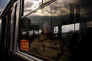 A passenger aboard a tram along the main line in downtown Sarajevo.