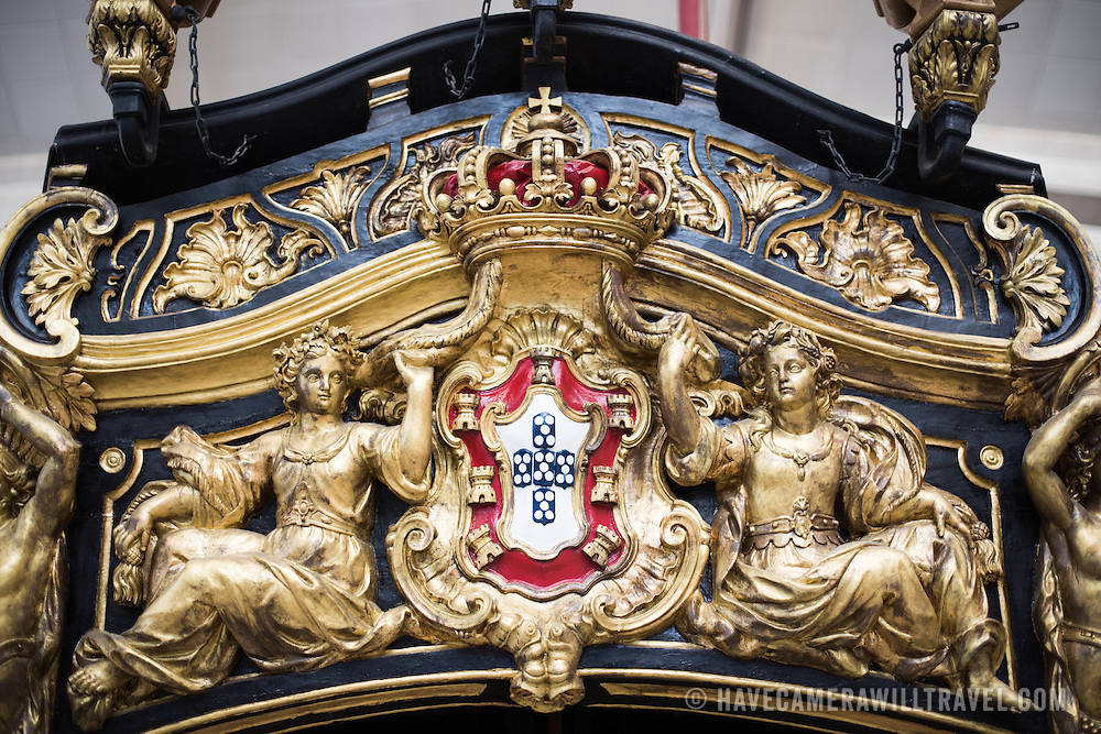 The decorated stern of the Royal Barge (Bergantim Real) was built in 1778 by order of Queen Maria I, in Lisbon, for the betrothal of Prince Joao, later King Joao VI. She was manned by 80 oarsmen, 1 coxswain, and 1 bowman. The last time she was in service was in transporting Queen Elizabeth II on the River Tagus during her visit in 1957. The Museu de Marinha (Maritime Museum of Navy Museum) focuses on Portuguese maritime history. It features exhibits on Portugal's Age of Discovery, the Portuguese Navy, commercial and recreational shipping, and, in a large annex, barges and seaplanes. Located in the Belem neighborhood of Lisbon, it occupies, in part, one wing of the Jerónimos Monastery. Its entrance is through a chapel that Henry the Navigator had built as the place where departing voyagers took mass before setting sail. The museum has occupied its present space since 1963.