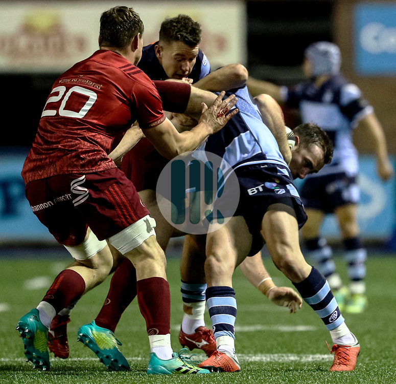 JJ Hanrahan of Munster is tackled by Tomos Williams of Cardiff Blues<br /> <br /> Photographer Simon King/Replay Images<br /> <br /> Guinness PRO14 Round 4 - Cardiff Blues v Munster - Friday 21st September 2018 - Cardiff Arms Park - Cardiff<br /> <br /> World Copyright © Replay Images . All rights reserved. info@replayimages.co.uk - http://replayimages.co.uk
