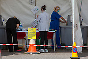 NHS staff wash their hands thoroughly after seeing a patient at a drive-through Primary Care Clinical Assessment Centre where potentially infectious and symptomatic Coronavirus patients can be assessed and treated by a doctor or a nurse, in a safe site, on the 16th of April 2020 in Dover, United Kingdom. This is not a COVID-19 testing facility, all patients will only be clinically assessed on site as there is no community testing currently available. All patients have been referred to this centre by NHS 111 or their GP.  (photo by Andy Aitchison)