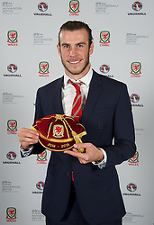 CARDIFF, WALES - Monday, October 5, 2015: Wales' Gareth Bale with his Welsh Cap during the FAW Awards Dinner at Cardiff City Hall. (Pic by David Rawcliffe/Propaganda)