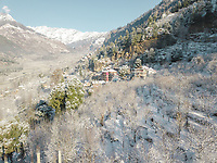 Aerial view of snowfall in the hills of vashisht area overlooking mountains of Himalayan range of Manali, Himachal Pradesh, India.