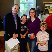 Artist John Stobart speaks with fans after giving a talk about his work at The Discover Center in Portsmouth, NH. June, 2012.