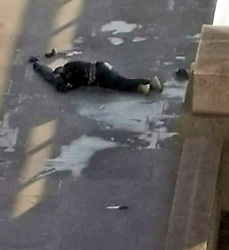 © Licensed to London News Pictures. 29/11/2019. London, UK. The body of a man lies motionless on London Bridge, close to what appears to be a knife (foreground) after police shot the man following reports of a series of stabbings. Photo credit: LNP