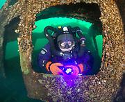 KISS Spirit rebreather diver inside Silver Comet at Dutch Springs, Scuba Diving Resort in Pennsylvania