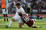 Jack Cork of Swansea City (L) holds off  Mark Noble of West Ham United (R). Premier league match, West Ham Utd v Swansea city at the London Stadium, Queen Elizabeth Olympic Park in London on Saturday 8th April 2017.<br /> pic by Steffan Bowen, Andrew Orchard sports photography.