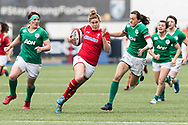 Dyddgu Hywel of Wales runs past Hannah Tyrrell (r) and Lindsay Peat (l) of Ireland.<br /> RBS Womens Six Nations 2017 international rugby, Wales women v Ireland women at the BT Sport Cardiff Arms Park in Cardiff , South Wales on Saturday 11th March 2017.  pic by Simon Latham, Andrew Orchard sports photography