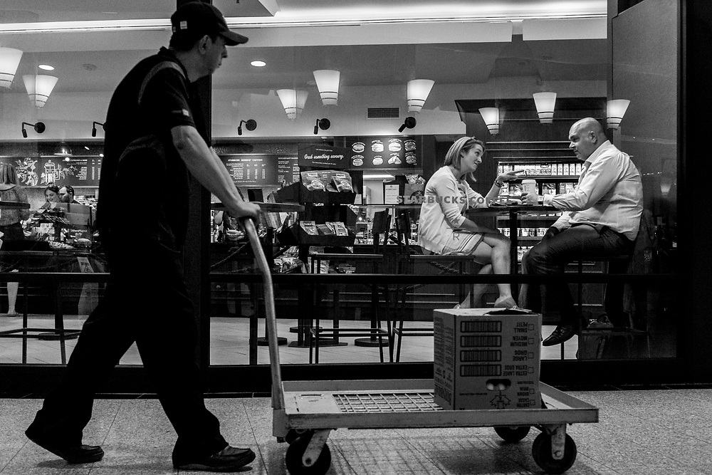 A street photograph made inside an underground plaza in the financial district of Toronto's financial district