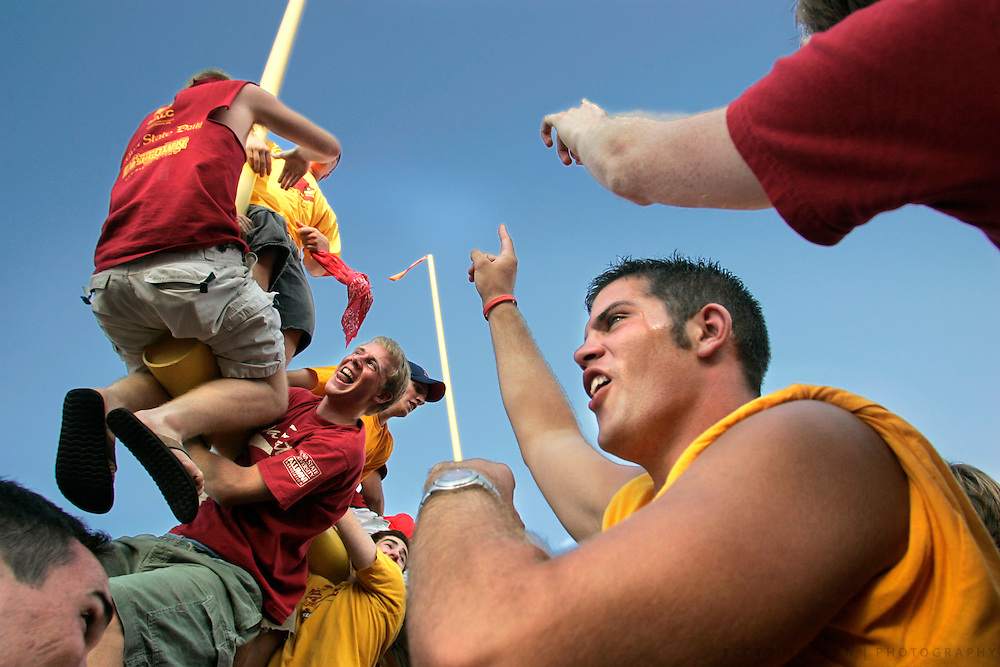 Scott Morgan/The Hawk Eye.Iowa State fan Matt Daugharthy, 20, of Des Moines cheers for his team while other fans climb the goal posts after their 23-3 win over Iowa Saturday, Sept. 10, 2005, at Jack Trice Stadium in Ames, Iowa.