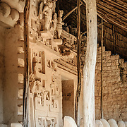 "Carved decorations on the exterior of the Tomb of Ukit Kan Le'k Tok' on top of the Acropolis on the northern side of the Ek'Balam archeological site on Mexico's Yucatan Peninsula. At the bottom of frame are some of the carved jaguar teeth protecting the doorway. It was once a thriving city of Maya Civilization dating to the Late Classic period. It is 30km north of Valladolid and is named for ""Black Jaguar"" a distinctive motif throughout the site."