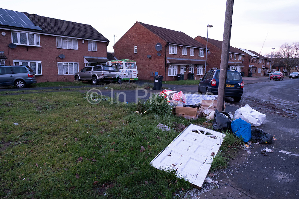Fly tipped waste on the street in a housing estate in Highgate close to the city centre on 14th December 2020 in Birmingham, United Kingdom. Illegal dumping, also called fly dumping or fly tipping, is the dumping of waste illegally instead of using an authorised method such as kerbside collection or using an authorised rubbish dump. It is the illegal deposit of any waste onto land, including waste dumped or tipped on a site with no licence to accept waste.