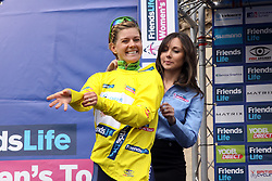©Licensed to London News Pictures. 07/05/2014<br /> Northampton, Northamptonshire. Emma Johansson for Orica AIS puts on the Yellow Jersey after winning the first stage of the Friends Womens Tour in Northampton.<br /> Photo credit: Steven Prouse/ LNP