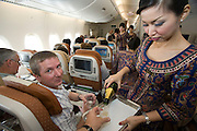 Airbus A380 first commercial flight - Singapore Airlines SQ 380 Singapore-Sydney on October 25, 2007.  Economy Class. Austrian passenger Dipl.-Ing. Hans Albrecher getting a glas of champagne.