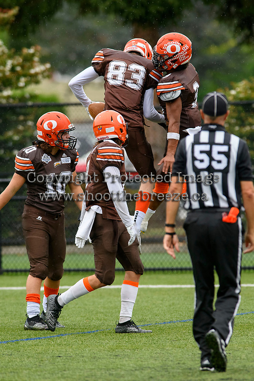 CHILLIWACK, BC - SEPTEMBER 11: Colby Milleto #10, Mike O'Shea #83, Malcolm Miller #3 and Matthew Sibley #9 of Okanagan Sun celebrate a touchdown against the Westshore Rebels at Exhibition Stadium in Chilliwack, BC, Canada. (Photo by Marissa Baecker/Shoot the Breeze)