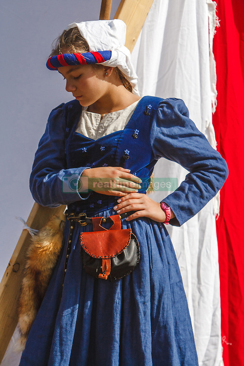 September 30, 2018 - Uzhhorod, Ukraine - A woman in a period medieval dress stands by a tent during the Drugeths' Day celebration, Uzhhorod, western Ukraine, September 30, 2018. The event marks 700 years since the first members of the Drugeth family settled in Uzhhorod. Originally from Apulia in Italy, the rich and influential Hungarian family owned Uzhhorod and made a considerable contribution into its development. Ukrinform. (Credit Image: © Serhiy Hudak/Ukrinform via ZUMA Wire)