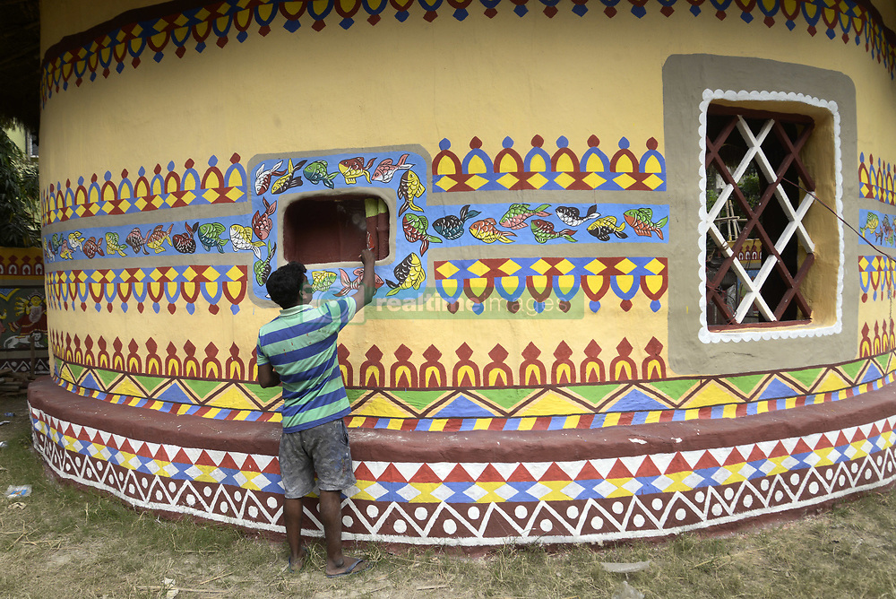 October 9, 2018 - Kolkata, West Bengal, India - An Artist gives final touch to the Pally Unnayan Samity a community puja pandal or temporary platform themed traditional Bengali clay house ahead of Durga Puja Festival. The annual five days festival begins on October 15 and worship Goddess Durga who symbolized power and the triumph of good over evil in Hindu mythology. (Credit Image: © Saikat Paul/Pacific Press via ZUMA Wire)