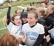 Saint Joseph's Georgia Place, 23, and Natalie Moore celebrate with their team after winning the semi-state soccer game against Belmont at Saint Joseph High School.
