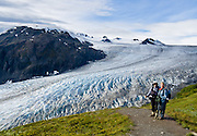 """Exit Glacier flows from the Harding Icefield in the Kenai Mountains of Alaska, USA. The only road into Kenai Fjords National Park is a spur of the Seward Highway to Exit Glacier, one of the most visited glaciers in Alaska. It was named after the exit of the first recorded crossing of Harding Icefield in 1968. Hike trails to the glacier terminus or up to Harding Icefield. From 1815-1999, the Exit Glacier in Alaska retreated 6549 feet, melting an average of 35 feet per year (according to www.nps.gov/kefj/). Over the past 50 years, Alaska's winters have warmed by 6.3°F (3.5°C) and its annual average temperature has increased 3.4°F (2.0°C) (Karl et al. 2009). Alaska has warmed more than twice as fast as the continental United States. Since the industrial revolution began, humans have increased atmospheric carbon dioxide concentration by 35% through burning fossil fuels, deforesting land, and grazing livestock. An overwhelming consensus of climate scientists agree that global warming is indeed happening and humans are contributing to it through emission of greenhouse gases (primarily carbon dioxide). The UN Intergovernmental Panel on Climate Change (IPCC, 2007) says """"Warming of the climate system is unequivocal, as is now evident from observations of increases in global average air and ocean temperatures, widespread melting of snow and ice and rising global average sea level. There is very high confidence that the net effect of human activities since 1750 has been one of warming."""""""