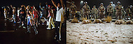 LEFT:  Protesters line West Florissant Avenue during a standoff with police early Saturday, Aug. 16, 2014, in Ferguson, Missouri.<br /> <br /> RIGHT:  Members of the National Guard stand outside the Ferguson Police Department on Wednesday, Nov. 26, 2014.