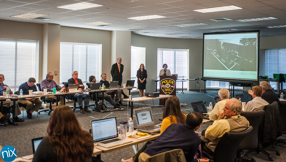 Concord City Council members and city staff listen to a presentation during the city's annual planning session at the Concord Police Headquarters Friday afternoon.