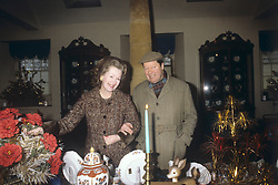 8th Earl Spencer, father of Princess Diana, with his wife, Raine Spencer, Countess Spencer, at their home at Althorp, Northamptonshire, which is open to the public. They are pictured here in the souvenir shop on the estate.