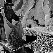 """When a miner dies in a gallery his widow is granted the right to be a """"palliri"""". The """"palliri"""" collect the rocks that the miners dispose of in order to recover the silver or tin remains they contain. Cerro Rico of Potosí. Bolivia."""