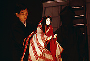 A man performs with a Geisha puppet at a theatre in Japan