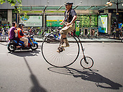 21 SEPTEMBER 2014 - BANGKOK, THAILAND: A man rides his late 19th century bicycle up Silom Road in Bangkok during Car Free Day. Bangkok hosted Car Free Day 2014 Sunday. Silom Road, the major thoroughfare in Bangkok's financial district, was closed to cars so bicyclists could use the road. The event was to promote the use of mass transit and environmentally friendly means of transportation. About 20,000 people were expected to participate in a city wide bike riding rally.   PHOTO BY JACK KURTZ