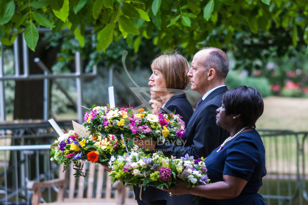 Hyde Park, London, July7th 2015. The Mayor of London Boris Johnson and other senior political figures, the Commissioners for transport and policing in the capital, as well as senior representatives of the emergency services  lay wreaths at the 7/7 memorial in Hyde Park. PICTURED:  (L-R)Harriet Harman, Chair of London Councils Jules Pipe and Chair of the London Assembly Jenette Arnold OBE
