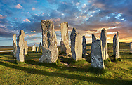 Calanais Standing Stones central stone circle, at sunset, erected between 2900-2600BC measuring 11 metres wide. At the centre of the ring stands a huge monolith stone 4.8 metres high weighing about 7 tonnes, which is perfectly orientated so that its widest sides face due north south. Calanais Neolithic Standing Stone (Tursachan Chalanais) , Isle of Lewis, Outer Hebrides, Scotland. .<br /> <br /> Visit our SCOTLAND HISTORIC PLACXES PHOTO COLLECTIONS for more photos to download or buy as wall art prints https://funkystock.photoshelter.com/gallery-collection/Images-of-Scotland-Scotish-Historic-Places-Pictures-Photos/C0000eJg00xiv_iQ<br /> '<br /> Visit our PREHISTORIC PLACES PHOTO COLLECTIONS for more  photos to download or buy as prints https://funkystock.photoshelter.com/gallery-collection/Prehistoric-Neolithic-Sites-Art-Artefacts-Pictures-Photos/C0000tfxw63zrUT4