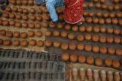 August 3, 2017 - Bhaktapur, Nepal - A woman arranges handmade clay pots at the ancient city of Bhaktapur in Nepal on Thursday, August 03, 2017. (Credit Image: © Skanda Gautam via ZUMA Wire)