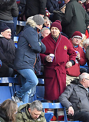 A Burnley fan in the stands during the Emirates FA Cup, third round match at Turf Moor, Burnley.