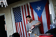 """BETHLEHEM, PA – JUNE 19, 2011: Aeri Rosto, 53, grills hot dogs and shish kabobs to celebrate Father's Day outside the home of Eugenia Rivera, a Hispanic South Side Bethlehem resident. Rosto has lived the U.S. for 32 years. """"My father was a cook,"""" he said. """"I started cooking with him when I was eight years old. I love it here. I have my 3 kids, my grandson. It's a great place to live.""""<br /> Although Rosto lives in Bethlehem, he works in Somerville, New Jersey to support his family, commuting 45 minutes to work each day.<br /> <br /> As the population of second and third generation Hispanics increases dramatically in the United States, a new boldness can be sensed among Latinos in America, stretching far beyond the southern border states. Demographers in Pennsylvania say the towns of Bethlehem, Allentown and Reading are set to become majority-minority cities, where Hispanics comprise a bigger portion of the population than whites. As this minority population increases dramatically in the region, Latinos are inching closer to their own realization of the American Dream, while gradually shifting the physical and cultural landscapes of their communities."""